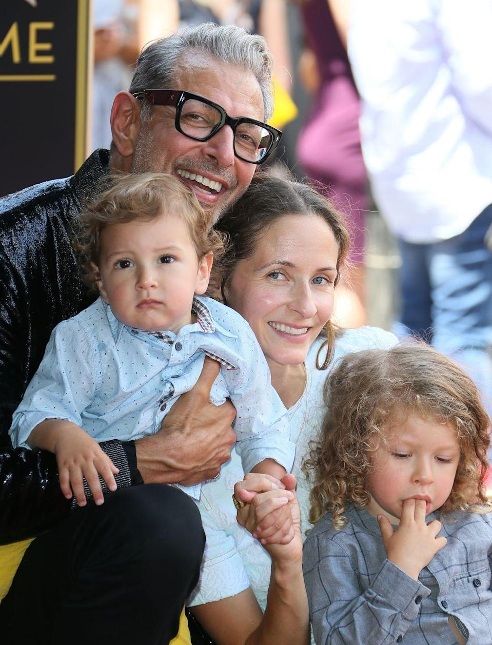 """<p><strong>Children</strong>: Charlie Ocean Goldblum (4) and River Joe Goldblum (3)</p><p>Although the 67-year-old actor became a dad later in life, he """"wildly appreciates"""" his fatherhood experience said that he feels """"right on schedule,"""" in a 2018 <a href=""""https://www.usmagazine.com/celebrity-moms/news/jeff-goldblum-opens-up-about-being-an-older-dad/"""" rel=""""nofollow noopener"""" target=""""_blank"""" data-ylk=""""slk:interview with Us Weekly"""" class=""""link rapid-noclick-resp"""">interview with <em>Us Weekly</em></a>. </p>"""