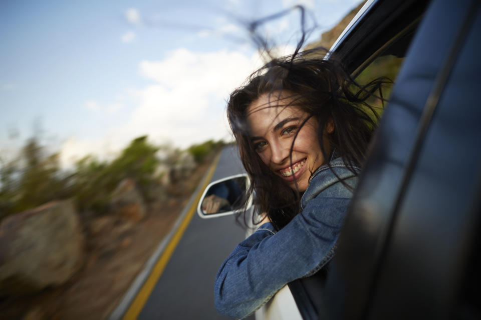 You'll be this happy after cleaning your car too. (Photo: Getty Images)