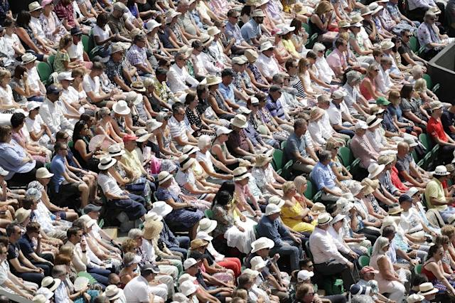 Spectators watch the action on Centre Court (AFP Photo/Ben Curtis)