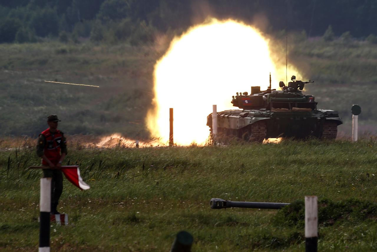 A T-72 tank, operated by a crew from Laos, fires at a target during the Tank Biathlon competition, part of the International Army Games 2017, at a range in the settlement of Alabino outside Moscow, Russia, July 29, 2017.  REUTERS/Maxim Shemetov
