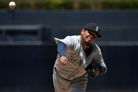 Apr 24, 2019; San Diego, CA, USA; Seattle Mariners starting pitcher Felix Hernandez (34) pitches during the first inning against the San Diego Padres at Petco Park. Mandatory Credit: Jake Roth-USA TODAY Sports