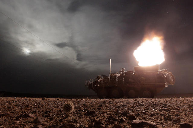 <p>A Stryker armored vehicle from the U.S. Army's MGS Platoon, Alpha Company, 4-23 Infantry Battalion, 5th Stryker Brigade Combat Team fires a 120mm mortar during a night patrol in Kandahar, on April 27, 2010. (Photo: Tim Wimborne/Reuters) </p>