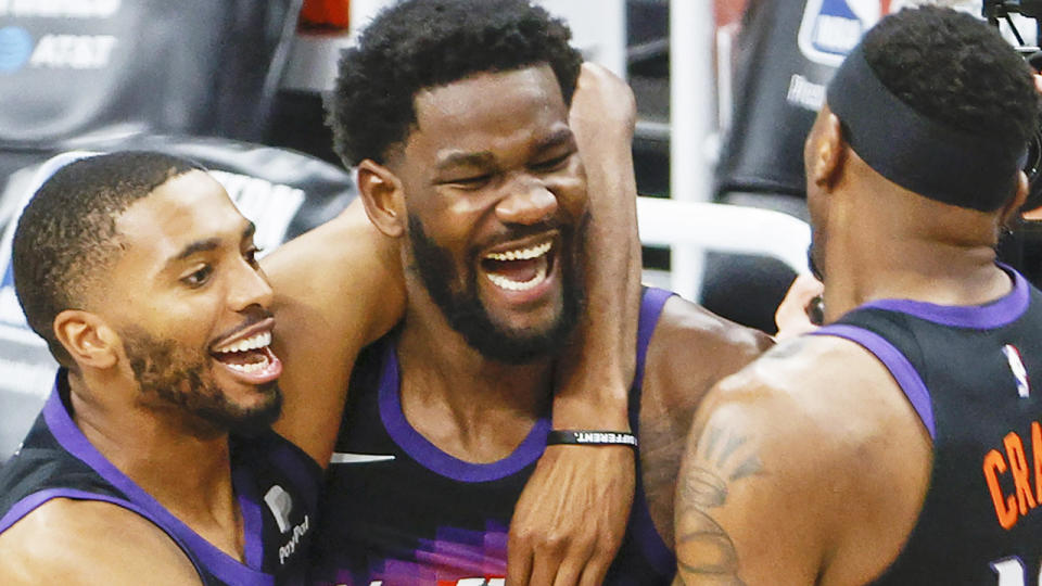 DeAndre Ayton celebrates with Phoenix Suns teammates after winning game two of the Western Conference Finals.