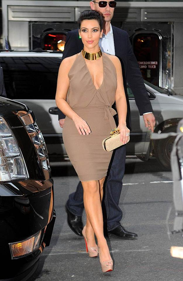 Kim Kardashian's getups are either hit or miss, and I happen to think she nailed it with this one. The newlywed/reality mogul rocked a sexy-yet-chic, neutral-colored frock, gold choker, and sky-high Louboutin peep-toes while en route to ABC's New York studios earlier this week.  Splash News - October 10, 2011