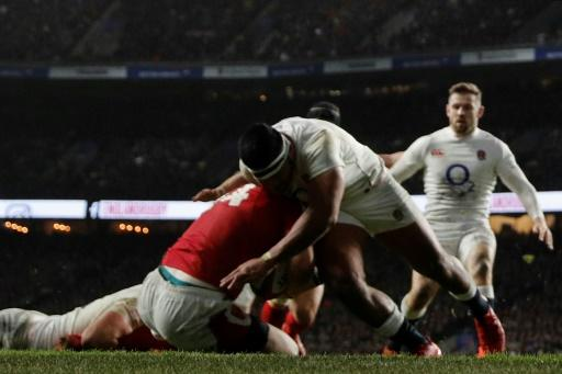 Controversial challenge - Manu Tuilagi (C) tackles Wales' wing George North in an incident that saw the England centre shown a red card