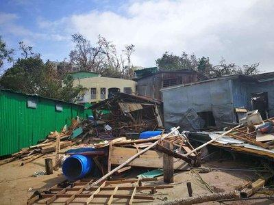 Before and after photos show one of the homes completely destroyed by Typhoon Hato and subsequently rebuilt with Sands China's assistance.