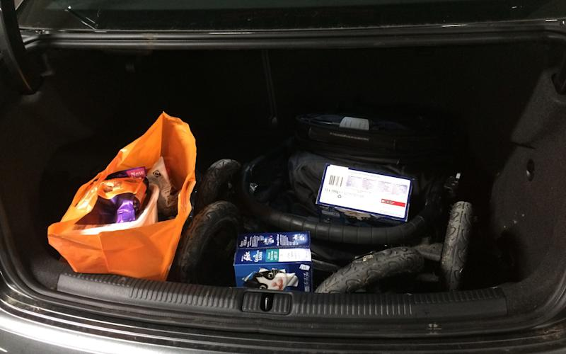 Audi A3 Saloon boot loaded with baby buggy