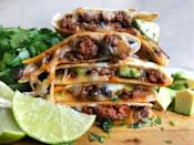 """<p>Don't worry, you can still dip them in guac.</p><p>Get the <a href=""""https://www.delish.com/uk/cooking/recipes/a29455944/cheesy-beef-quesadillas-recipe/"""" rel=""""nofollow noopener"""" target=""""_blank"""" data-ylk=""""slk:Cheesy Beef Quesadillas"""" class=""""link rapid-noclick-resp"""">Cheesy Beef Quesadillas</a> recipe. </p>"""