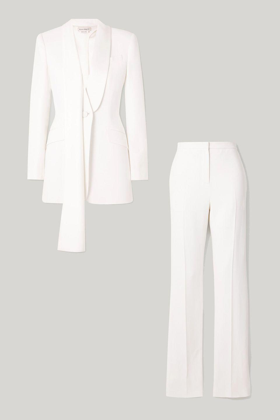 "<p>A sleek white tux is a bridal standard—and we suggest wearing this look without a shirt underneath for evening. Pair straight or wide-legged trousers with a pointed-toe pump to keep your legs looking extra long.</p><p><em>Draped blazer, $2,690, <a href=""https://www.net-a-porter.com/en-us/shop/product/alexander-mcqueen/draped-cutout-crepe-blazer/1301270"" rel=""nofollow noopener"" target=""_blank"" data-ylk=""slk:net-a-porter.com"" class=""link rapid-noclick-resp"">net-a-porter.com</a></em> <a class=""link rapid-noclick-resp"" href=""https://go.redirectingat.com?id=74968X1596630&url=https%3A%2F%2Fwww.net-a-porter.com%2Fen-us%2Fshop%2Fproduct%2Falexander-mcqueen%2Fdraped-cutout-crepe-blazer%2F1301270&sref=https%3A%2F%2Fwww.harpersbazaar.com%2Fwedding%2Fbridal-fashion%2Fg35154193%2Fbest-wedding-suits-for-women%2F"" rel=""nofollow noopener"" target=""_blank"" data-ylk=""slk:SHOP"">SHOP</a></p><p><em>Slim-leg pants, $860, <a href=""https://www.net-a-porter.com/en-us/shop/product/alexander-mcqueen/crepe-slim-leg-pants/1301273"" rel=""nofollow noopener"" target=""_blank"" data-ylk=""slk:net-a-porter.com"" class=""link rapid-noclick-resp"">net-a-porter.com</a></em> <a class=""link rapid-noclick-resp"" href=""https://go.redirectingat.com?id=74968X1596630&url=https%3A%2F%2Fwww.net-a-porter.com%2Fen-us%2Fshop%2Fproduct%2Falexander-mcqueen%2Fcrepe-slim-leg-pants%2F1301273&sref=https%3A%2F%2Fwww.harpersbazaar.com%2Fwedding%2Fbridal-fashion%2Fg35154193%2Fbest-wedding-suits-for-women%2F"" rel=""nofollow noopener"" target=""_blank"" data-ylk=""slk:SHOP"">SHOP</a></p>"