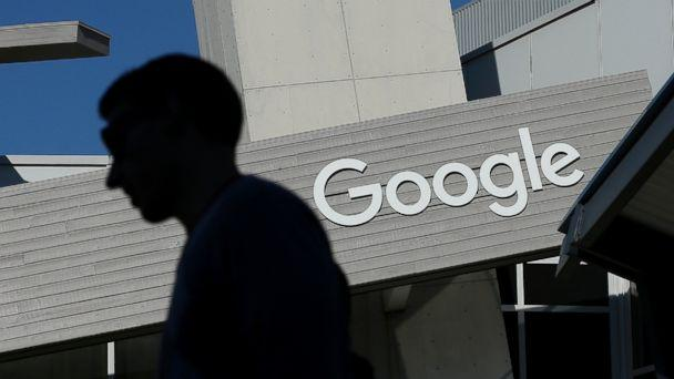 A man walks past a building on the Google campus in Mountain View, Calif. (Jeff Chiu/AP Photo)
