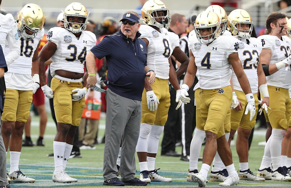 Notre Dame coach Brian Kelly looks on before a bowl game against Iowa State on Dec. 28, 2019. (Stephen M. Dowell/Orlando Sentinel/Tribune News Service via Getty Images)
