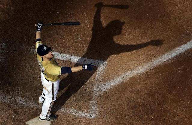 Milwaukee Brewers' Jonathan Lucroy watches a foul ball during the eighth inning of a baseball game against the Los Angeles Angels, Sunday, Sept. 1, 2013, in Milwaukee. (AP Photo/Morry Gash)