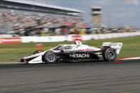 Josef Newgarden drives into turn one during the IndyCar auto race Sunday, Oct. 25, 2020, in St. Petersburg, Fla. (AP Photo/Mike Carlson)