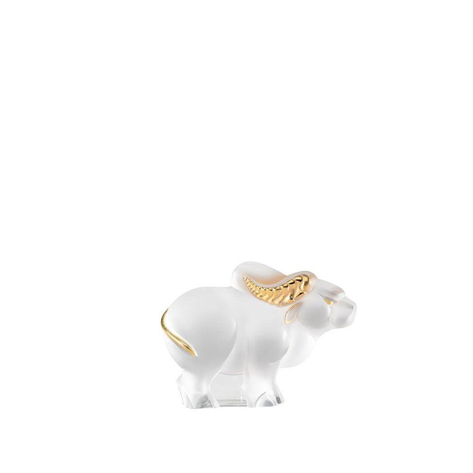 "<p><strong>Lalique</strong></p><p>lalique.com</p><p><strong>$720.00</strong></p><p><a href=""https://www.lalique.com/en/catalog/homeware/home-accessories/sculptures/ox-small-size-sculpture/clear-gold-stamped"" rel=""nofollow noopener"" target=""_blank"" data-ylk=""slk:Shop Now"" class=""link rapid-noclick-resp"">Shop Now</a></p><p>A diminutive gold-stamped embodiment of strength and virility.</p>"