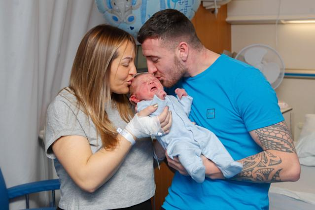 Emma Allan and Cameron Cunningham welcomed a baby boy just three minutes into the new decade. [SWNS]