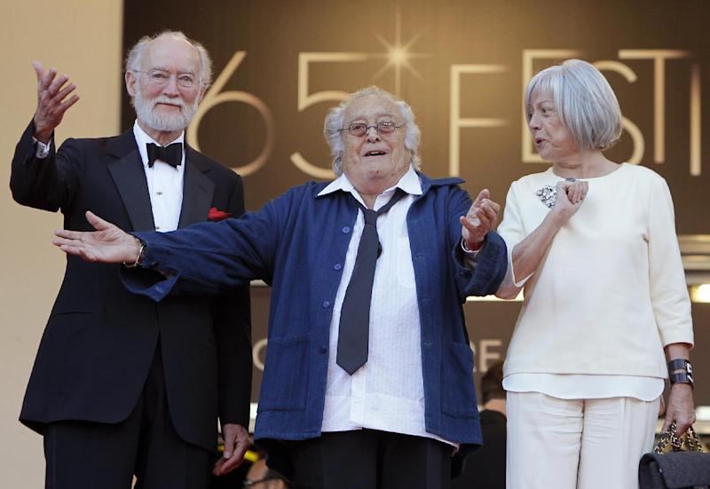 "File - This May 24, 2012 file photo shows French film director Georges Lautner, centre, gesturing as he arrives for the screening of The Paperboy at the 65th international film festival, in Cannes, southern France. Georges Lautner, has died aged 87 it was announced Saturday Nov. 23 2013. . Of the dozens of films he made, ""Les Tontons Flingeurs,"" which appeared as ""Monsieur Gangster"" for Anglophone audiences, was perhaps the most beloved. Standing at left is Gaumont chairman Nicolas Seydoux, and at right Georges Lautner's companion Martine.(AP Photo/Francois Mori, file)"