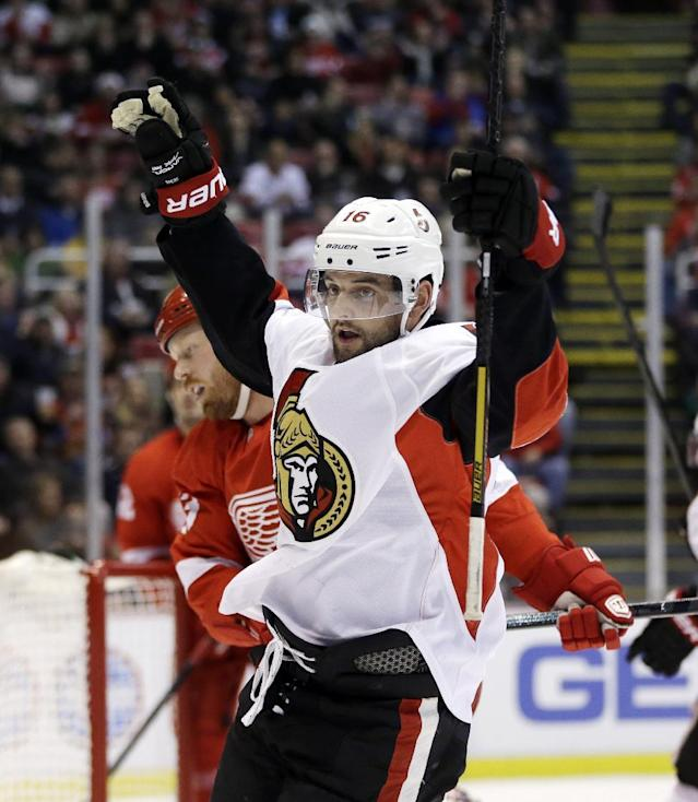 Ottawa Senators left wing Clarke MacArthur reacts after scoring during the first period of an NHL hockey game against the Detroit Red Wings in Detroit, Saturday, Nov. 23, 2013. (AP Photo/Carlos Osorio)