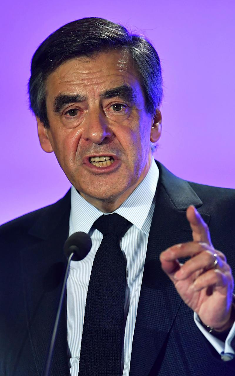 French presidential election candidate for the right-wing Les Republicains (LR) party Francois Fillon speaks during a campaign rally on March 2, 2017 in Nimes - Credit: PASCAL GUYOT/AFP