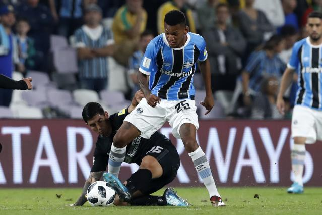 Brazil's Gremio Jailson, right, and Mexico's Pachuca Victor Guzman fight for the ball during the Club World Cup semifinal soccer match between Gremio and Pachuca at the Hazza Bin Zayed stadium in Al Ain, United Arab Emirates, Tuesday, Dec. 12, 2017. (AP Photo/Hassan Ammar)