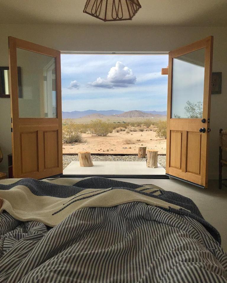 <p>In fourth place, is a 1950s renovated cabin which sits on over 22 acres of impressive land in Joshua Tree, California. Fancy having your morning brew with that for a backdrop, eh? <em>[Photo: Airbnb]</em> </p>