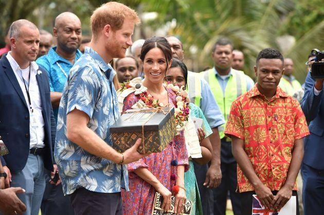 The royal couple receive a giftfrom the University of the South Pacific after Meghan recounts her own struggles to afford her university degree.