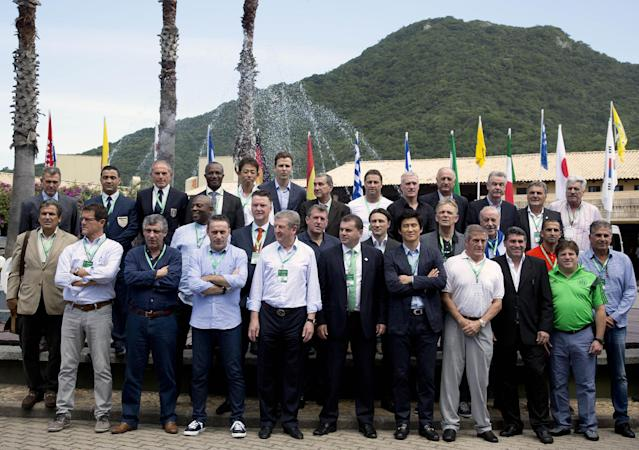 National soccer coaches and team representatives pose for a picture during the Team Workshop for the 2014 FIFA World Cup at the Costao do Santinho hotel in Florianopolis, Brazil, Wednesday, Feb. 19, 2014. With the start of the World Cup a few months away, FIFA says it will not pay some of Brazil's World Cup bills even though it admits the local organizers' failure to fulfill their commitments may jeopardize the tournament's success. (AP Photo/Andre Penner)