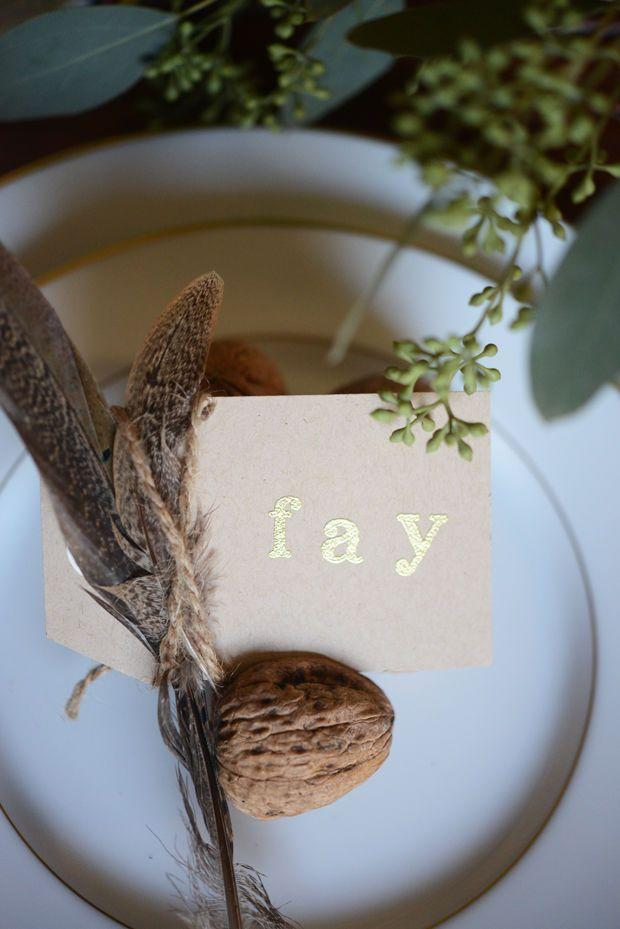 "<p>If you're a fan of earthy elements, you'll love this DIY place card idea.</p><p><strong>Get the tutorial at <a href=""http://cupcakesandcashmere.com/decor/thanksgiving-glimpse"" rel=""nofollow noopener"" target=""_blank"" data-ylk=""slk:Cupcakes and Cashmere"" class=""link rapid-noclick-resp"">Cupcakes and Cashmere</a>.</strong></p><p><a class=""link rapid-noclick-resp"" href=""https://www.amazon.com/MagiDeal-Natural-Shooting-Christmas-Decoration/dp/B07FP39XVH?tag=syn-yahoo-20&ascsubtag=%5Bartid%7C10050.g.1538%5Bsrc%7Cyahoo-us"" rel=""nofollow noopener"" target=""_blank"" data-ylk=""slk:SHOP PINECONES"">SHOP PINECONES</a> </p>"