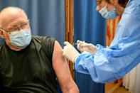 Laszlo Cservak, a 75-year-old pensioner, receives his first dose of the Covid-19 vaccine developed by China's Sinopharm company and approved by Hungarian authorities