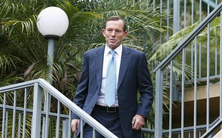 Australia's conservative leader and Prime Minister-elect Tony Abbott leaves his house in Sydney