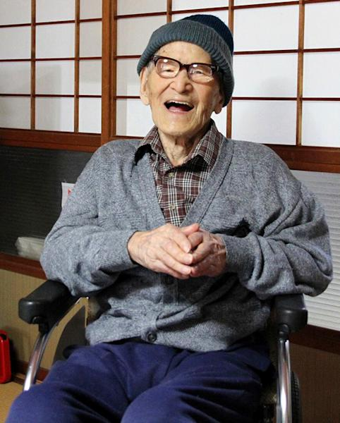 ADDS AGE - FILE - In this file photo taken Oct. 15, 2012 and released by Kyotango City, Jiroemon Kimura smiles after he was presented with the certificate of the world's oldest living man from Guinness World Records Editor-in-Chief Craig Glenday at his home in the city, Kyoto Prefecture, Japan. Japanese media report that Kimura died of natural causes at a hospital in Kyotango early Wednesday, June 12, 2013 at the age of 116. (AP Photo/Kyotango City, File) EDITORIAL USE ONLY