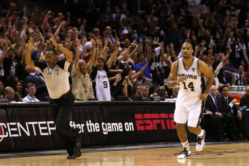 SAN ANTONIO, TX - JUNE 11: Gary Neal #14 of the San Antonio Spurs reacts after making a three-pointer in the fourth quarter while taking on the Miami Heat during Game Three of the 2013 NBA Finals at the AT&T Center on June 11, 2013 in San Antonio, Texas. (Photo by Mike Ehrmann/Getty Images)