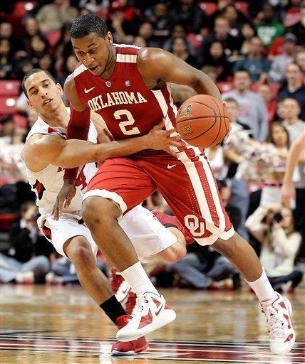 Oklahoma's Steven Pledger, right, is fouled by Texas Tech's Ty Nurse during their NCAA college basketball game in Lubbock, Texas, Saturday, Feb. 11, 2012. (AP Photo/Lubbock Avalanche-Journal, Zach Long) ALL LOCAL TV OUT