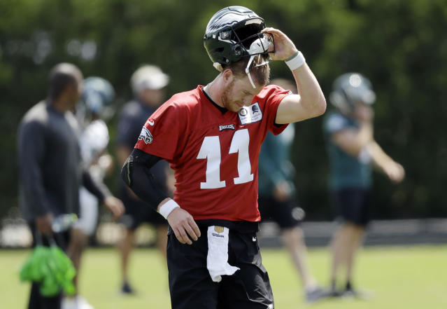 FILE - In this Thursday, June 7, 2018, file photo, Philadelphia Eagles' Carson Wentz runs a drill during an organized team activity at the NFL football team's practice facility in Philadelphia. Wentz was having an MVP season before a torn ACL forced him to the sideline where he watched Nick Foles lead the Philadelphia Eagles to their first Super Bowl victory. His friendship with Super Bowl MVP Nick Foles appears without the strain seen in other famed NFL tandems. (AP Photo/Matt Slocum, File)