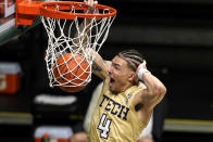 Georgia Tech guard Jordan Usher (4) dunks during the first half of an NCAA college basketball game against Miami, Saturday, Feb. 20, 2021, in Coral Gables, Fla. (AP Photo/Lynne Sladky)