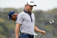 Justin Thomas reacts after missing his birdie putt on the 14th hole, in his match against Matt Kuchar, left, during a first round match at the Dell Technologies Match Play Championship golf tournament Wednesday, March 24, 2021, in Austin, Texas. (AP Photo/David J. Phillip)