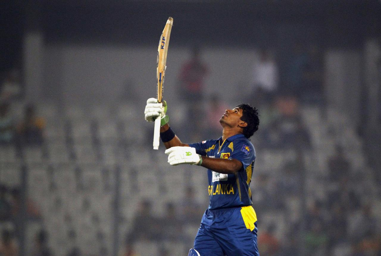 Sri Lanka's Kusal Perera celebrates after scoring a century on the third one day international cricket match against Bangladesh in Dhaka, Bangladesh, Saturday, Feb. 22, 2014. Sri Lanka won by 6 wickets. (AP Photo/A.M. Ahad)