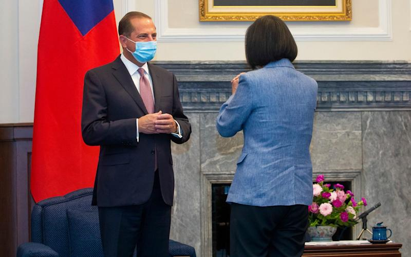 US Health and Human Services Secretary Alex Azar, left, is greeted by Taiwan's President Tsai Ing-wen, right, during a meeting in Taipei, Taiwan - Pool Central News Agency