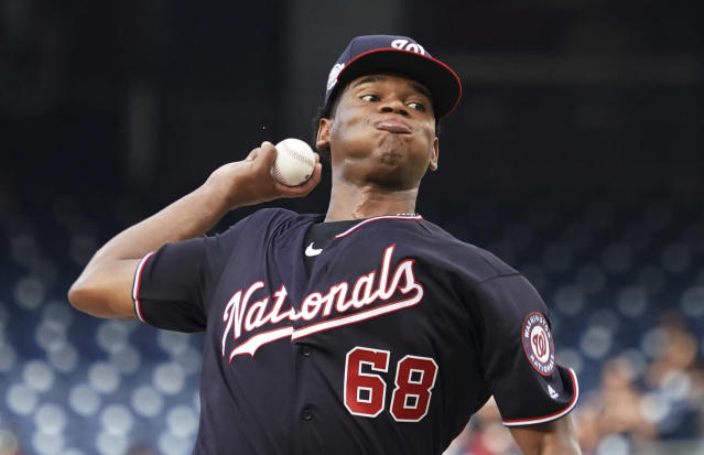 Washington Nationals starting pitcher Jefry Rodriguez throws during the first inning of the team's baseball game against the Baltimore Orioles at Nationals Park, Tuesday, June 19, 2018, in Washington. (AP Photo/Carolyn Kaster)