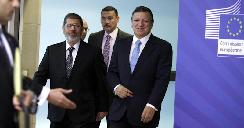 European Commission President Jose Manuel Barroso, center right, walks with Egyptian President Mohamed Morsi, center left, prior to a meeting at the EU headquarters in Brussels on Thursday, Sept. 13, 2012. (AP Photo/Virginia Mayo)