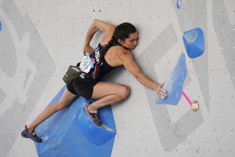 FILE - United States' Kyra Condie climbs during women's boulder qualification at the climbing World Cup on May 21, 2021, in Salt Lake City. Kyra Condie was told she needed back surgery to fix a severe curvature in her spine and would never be able to climb again. She did have surgery, after getting a second opinion, and has willed herself into becoming one of the world's elite climbers despite having 10 vertebrae fused together. (AP Photo/Rick Bowmer, File)