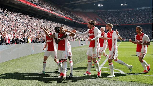 First-half goals from Lasse Schone and David Neres helped Ajax to a crucial 2-1 win over Feyenoord to reignite the Eredivisie title race.