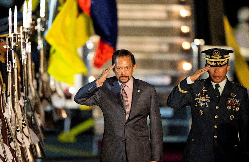 Brunei's Sultan Hassanal Bolkiah (C) caused controversy in 2014 when he introduced sharia law to the tiny, oil-rich nation (AFP Photo/NOEL CELIS)