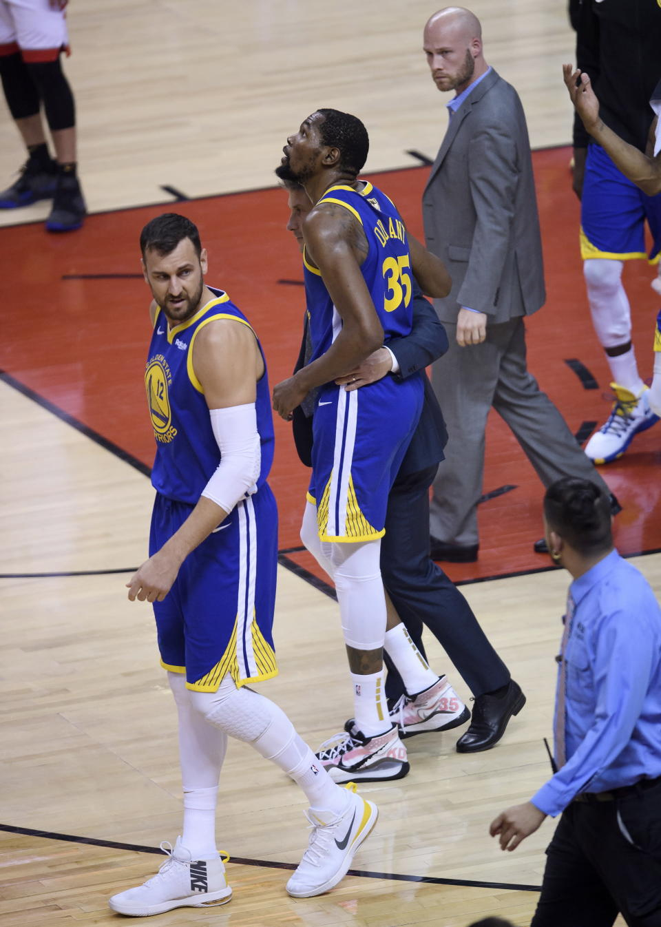 Golden State Warriors forward Kevin Durant (35) leaves after bering injured while playing against the Toronto Raptors during first-half basketball action in Game 5 of the NBA Finals in Toronto, Monday, June 10, 2019. (Nathan Denette/The Canadian Press via AP)