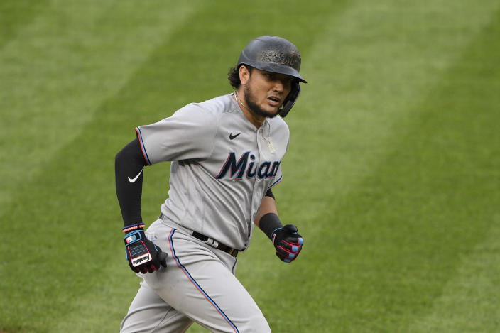 FILE - Miami Marlins' Miguel Rojas reacts as he rounds the bases on his three-run home run during a baseball game against the Washington Nationals in Washington, in this Friday, Aug. 21, 2020, file photo. Rojas has been with the Marlins since 2015, longer than any other player. He's a perfect fit for a small-budget team because he's an overachiever, and thus a sound investment. (AP Photo/Nick Wass, File)