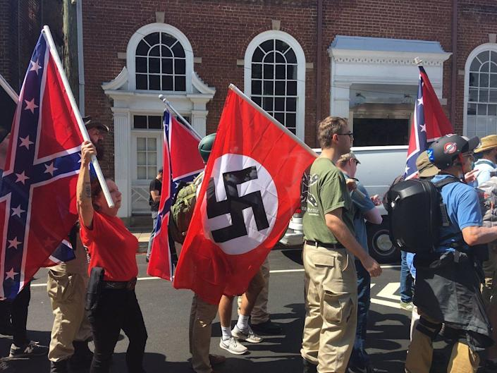 White supremacists carry Nazi flags on Aug. 12, 2017.