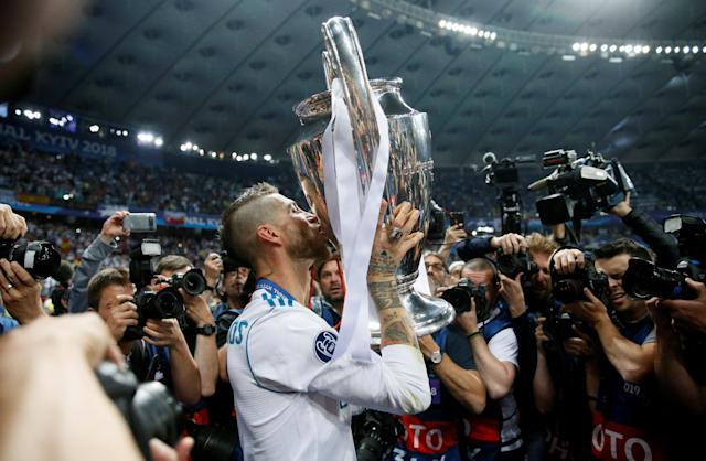 Soccer Football - Champions League Final - Real Madrid v Liverpool - NSC Olympic Stadium, Kiev, Ukraine - May 26, 2018 Real Madrid's Sergio Ramos kisses the trophy as he celebrates after winning the Champions League REUTERS/Gleb Garanich