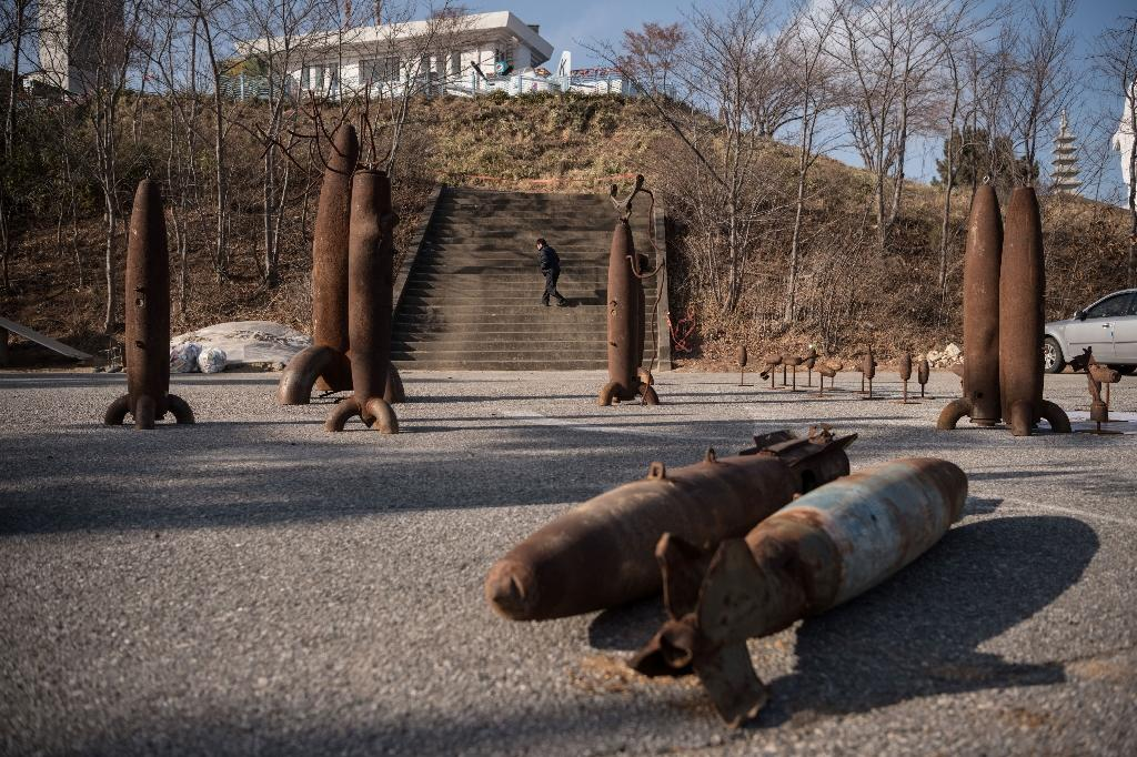 Rusting weaponry is on display for tourists on the southern side of the border (AFP Photo/Ed JONES)