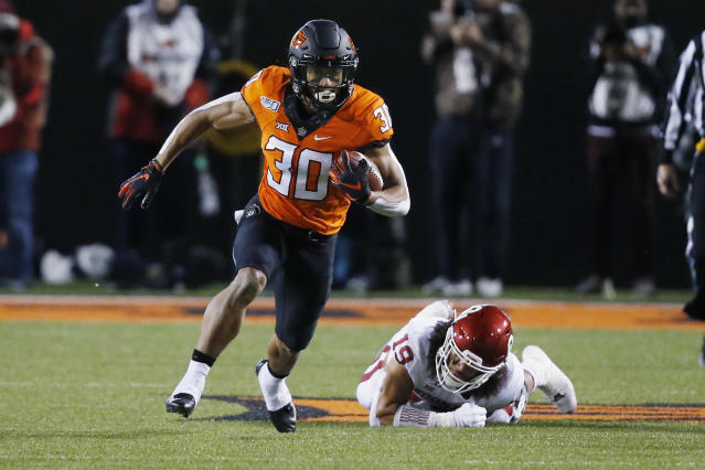 Oklahoma State running back Chuba Hubbard is one of the best backs in college football. (AP Photo/Sue Ogrocki)