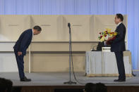 Japan's outgoing Prime Minister, Yoshihide Suga, left, bows to former Foreign Minister Fumio Kishida after Kishida was announced the winner of the Liberal Democrat Party leadership election in Tokyo Wednesday, Sept. 29, 2021. Kishida won the governing party leadership election on Wednesday and is set to become the next prime minister, facing the imminent task of addressing a pandemic-hit economy and ensuring a strong alliance with Washington to counter growing regional security risks. (Carl Court/Pool Photo via AP)