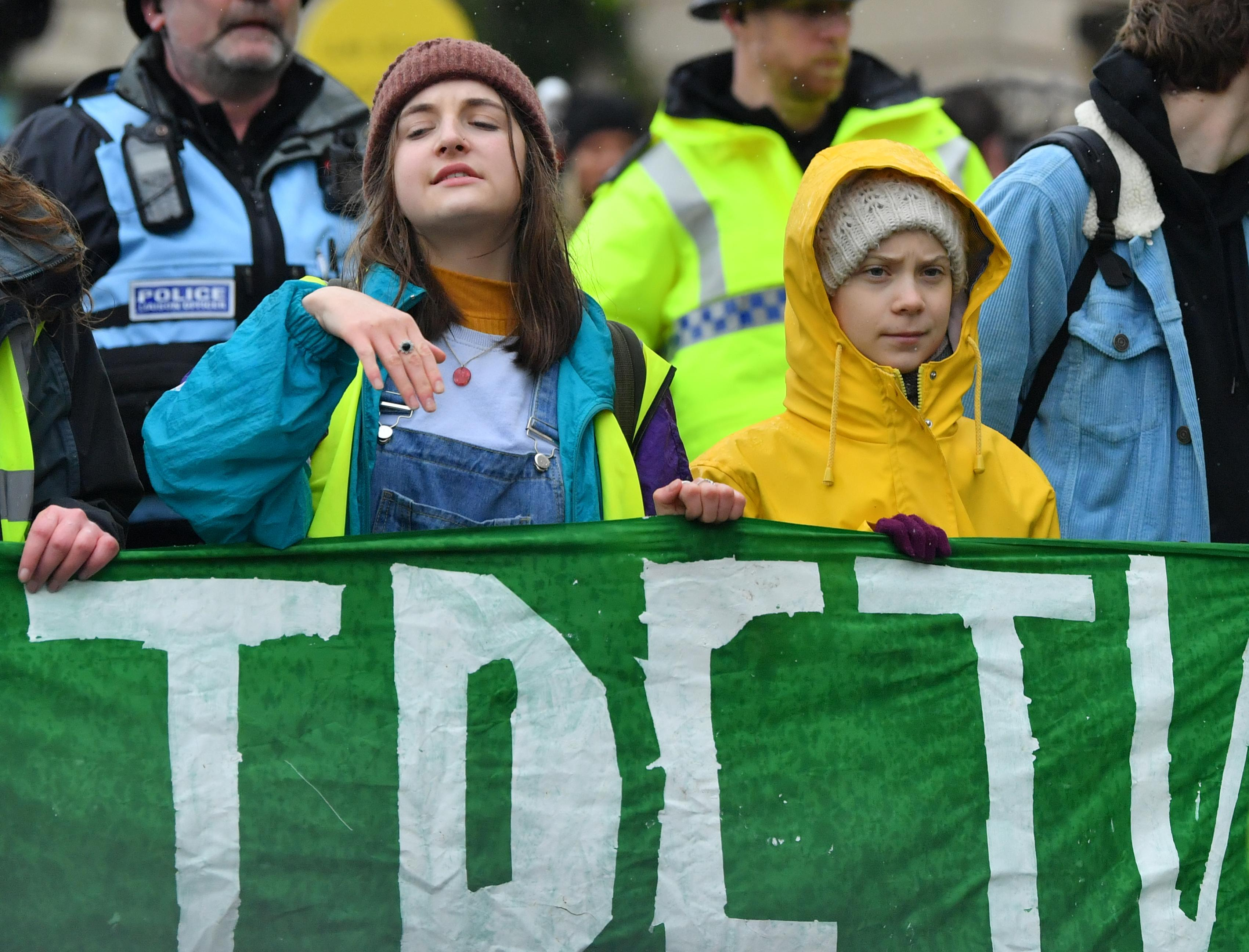 Environmental activist Greta Thunberg (right) marches during a Youth Strike 4 Climate protest in Bristol.